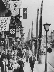 "<p>A street scene showing displays of the Olympic and German (swastika) flags in Berlin, site of the summer <a href=""/narrative/7139/en"">Olympic Games</a>. Berlin, Germany, August 1936.</p>"