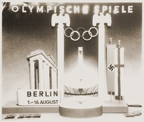 """<p>A display advertising the 11th Summer <a href=""""/narrative/7139/en"""">Olympic Games</a> which were held in Berlin, Germany, 1936.</p>"""