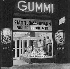 """<p>""""<a href=""""/narrative/21671/en"""">Aryanization</a>"""" of Jewish-owned businesses: a formerly Jewish-owned store (Gummi Weil) that was expropriated and transferred to non-Jewish ownership (Stamm and Bassermann). Frankfurt, Germany, 1938.</p>"""
