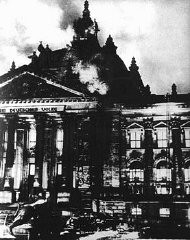 """<p>The Reichstag (German parliament) building burns in Berlin. Hitler used the event to convince President <a href=""""/narrative/19342/en"""">Hindenburg</a> to declare a state of emergency, <a href=""""/narrative/11461/en"""">suspending important constitutional safeguards</a>. Germany, February 27, 1933.</p>"""