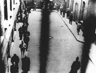 <p>Prisoners arrested during the crackdown on leftists and other targeted groups exercise in the courtyard of the Alexanderplatz prison. Munich, Germany, April 10, 1933.</p>