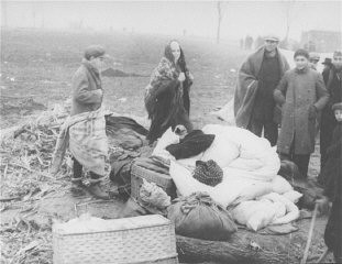 <p>Stateless Jewish refugees at theMischdorf tent campalong the Slovak-Hungarian border, following the First Vienna Award which gave a sector of southern Slovakia to Hungary. Local Jews were accused of supporting the Hungarian claim, were driven across the border, then back again, then were forced to live for weeks in an open field. November 1938.</p>