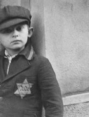 <p>This photograph shows a Jewish boy wearing the compulsory Star of David. Prague, Czechoslovakia, between September 1941 and December 1944.</p>