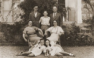 "<p>Members of the Amarillo family pose outside their home in <a href=""/narrative/5364/en"">Salonika</a>. Front, from left to right, are Tillie Amarillo and Sarika Yahiel. Seated behind them are their mothers Louisa Bourla Amarillo and Regina Amarillo Yahiel. Standing are Saul Amarillo, Isaccino Yahiel, and Isaac Yahiel. Salonika, <a href=""/narrative/4964/en"">Greece</a>, between 1930 and 1939.</p>"
