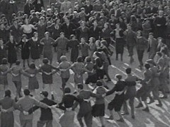 <p>Zionist youth sing while dancing the hora, a folk dance.</p>