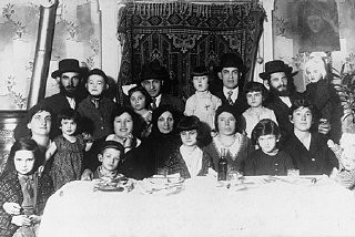 "<p>Portrait of the Ehrlich family seated around the family table. <a href=""/narrative/7590/en"">Munkacs</a>, Czechoslovakia, 1930.</p>