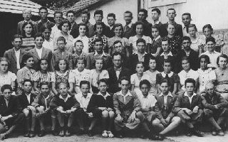 "<p>Group portrait of students and teachers at the Hebrew gymnasium in <a href=""/narrative/7590/en"">Munkacs</a>. 1936-1937.</p>"