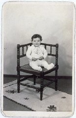 "<p>Portrait of Tsewie Herschel seated in a chair, taken while he was living in <a href=""/narrative/7711/en"">hiding</a>. Oosterbeek, the Netherlands, 1943–1944.</p>