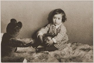 "<p>Photograph taken in December 1932 of Suse Grunbaum at age one. Soon after Hitler's 1933 <a href=""/narrative/65/en"">seizure of power</a> in Germany, two-year-old Suse and her parents fled to the Netherlands and settled in the town of Dinxperlo. In 1943, Jews in German-occupied Dinxperlo were ordered to assemble for deportation. Hearing of these plans, the Grünbaums went into hiding, finding refuge with Dutch farmers. The Hartemink family hid Suse and her mother for two years in their barn, first under the floorboards, then in a specially constructed hiding space.</p>"
