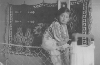 "<p>Portrait of a young Jewish girl, Lida Kleinman sitting in her room in Lacko, Poland, 1935. In January 1942, Lida was sent into hiding. She <a href=""/narrative/7723/en"">hid under false identities</a> in Catholic orphanages until the end of the war.</p>"