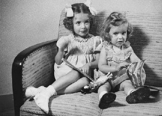 """<p>Sisters Eva and Liane Münzer.They were placed in hiding with a devout Catholic couple. In 1944, Eva and Liane were reported to the police as a result of a fight between their rescuers. The husband denounced his wife and the two Jewish girls. The three were immediately arrested and sent to the Westerbork camp. On February 8, 1944, eight- and six-year-old Eva and Liane were deported to <a href=""""/narrative/3673/en"""">Auschwitz</a>, where they were murdered. Photograph taken in The Hague, the Netherlands, 1940.</p>"""