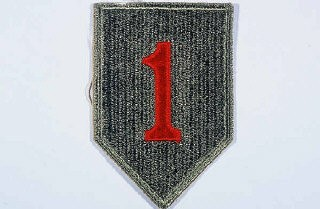 "<p>Insignia of the <a href=""/narrative/7798/en"">1st Infantry Division</a>. The 1st Infantry Division's nickname, the ""Big Red One,"" originated from the division's insignia, a large red number ""1"" on a khaki field. This nickname was adopted during <a href=""/narrative/28/en"">World War I</a>, when the 1st was the first American division to arrive in France.</p>"