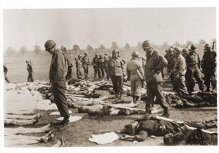 <p>American soldiers view the bodies of prisoners laid out in rows in an open field at Ohrdruf, a subcamp of Buchenwald in Germany. The 4th Armored and 89th Infantry Divisions liberated Ohrdruf on April 4, 1945. It was the first concentration camp American forces encountered and, as such, it revealed the extent of German atrocities in the camps. Generals Dwight D. Eisenhower, Omar Bradley, and George S. Patton visited Ohrdruf on April 12, 1945 to witness to the conditions there.</p>