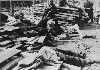 "<p>Survivors in <a href=""/narrative/3956/en"">Buchenwald</a> just after liberation. Troops of the US <a href=""/narrative/7812/en"">6th Armored Division</a> entered Buchenwald on April 11, and troops of the <a href=""/narrative/8053/en"">80th Infantry</a> arrived on April 12. Buchenwald, Germany, photograph taken ca. April 11, 1945.</p>"