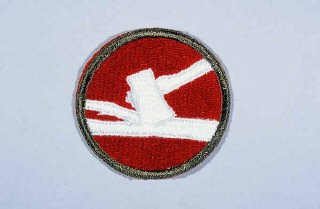 "<p>Insignia of the <a href=""/narrative/7824/en"">84th Infantry Division</a>. The 84th Infantry Division derives its nickname, ""Railsplitter"" division, from the divisional insignia, an ax splitting a rail. This design was created during <a href=""/narrative/28/en"">World War I</a>, when the division was known as the ""Lincoln"" division to represent the states that supplied soldiers for the division: Illinois, Indiana, and Kentucky. All figured prominently in the life of President Abraham Lincoln, of log-splitting legend.</p>"