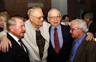 "<p>Liberator Vernon Tott (second from left) of the <a href=""/narrative/7824/en"">84th Infantry</a> was honored by some of the survivors he helped free from the Ahlem labor camp near Hanover, Germany. Tott's name was engraved on the Museum's Donor's Lounge wall with the inscription: ""In honor of Vernon W. Tott, my liberator & hero."" The ceremony in which Tott's name was unveiled came as a complete surprise to him. Washington, DC, November 2003.</p>"