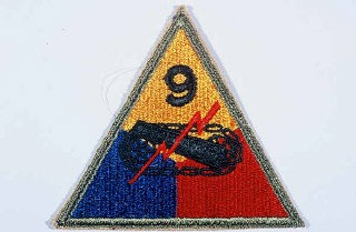 "<p>Insignia of the <a href=""/narrative/7884/en"">9th Armored Division</a>. Although no nickname for the 9th was in common usage throughout <a href=""/narrative/2388/en"">World War II</a>, ""Phantom"" division was sometimes used in 1945. It originated during the <a href=""/narrative/8156/en"">Battle of the Bulge</a>, when the 9th Armored Division seemed, like a phantom, to be everywhere along the front.</p>"