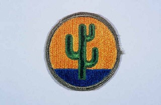 "<p>Insignia of the <a href=""/narrative/7954/en"">103rd Infantry Division</a>. The 103rd Infantry Division, the ""Cactus"" division, is so called after the 103rd's shoulder patch, a cactus in a gold circle. The cactus is representative of the states whose troops formed the unit in the early 1920s: Arizona, Colorado, and New Mexico.</p>"