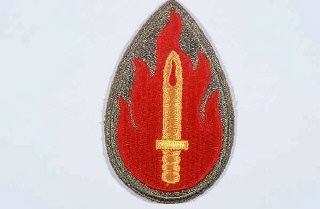 "<p>Insignia of the <a href=""/narrative/7962/en"">63rd Infantry Division</a>. The 63rd Infantry Division was nicknamed the ""Blood and Fire"" division soon after its formation in the spring of 1943. The nickname commemorates British prime minister Winston Churchill's statement at the Casablanca Conference in January 1943 that ""the enemy would bleed and burn in expiation of their crimes against humanity."" The divisional insignia illustrates the nickname.</p>"