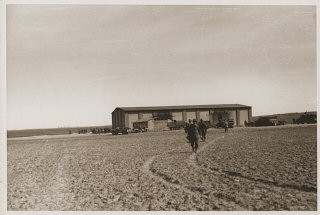 "<p>US troops with the <a href=""/narrative/7965/en"">102nd Infantry Division</a> at a barn outside Gardelegen, where over 1,000 prisoners were burned alive by <a href=""/narrative/10800/en"">the SS</a>. Germany, April 14, 1945.</p>"