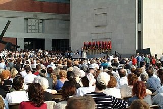<p>View of a ceremony held during the Museum's Tribute to Holocaust Survivors: Reunion of a Special Family, one of the United States Holocaust Museum's tenth anniversary events. Flags of the liberating divisions form the backdrop to the ceremony. Washington, DC, November 2003.</p>