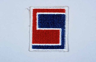 "<p>Insignia of the <a href=""/narrative/8041/en"">69th Infantry Division</a>. The 69th Infantry Division gained the nickname the ""Fighting 69th"" during <a href=""/narrative/2388/en"">World War II</a>. The name has no heraldic significance, but simply conveys the esprit de corps of the division.</p>"