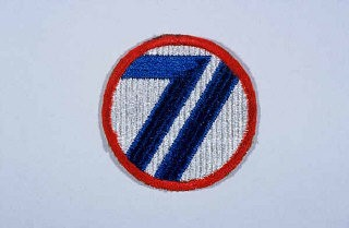 "<p>Insignia of the <a href=""/narrative/8044/en"">71st Infantry Division</a>. The nickname of the 71st Infantry Division, the ""Red Circle"" division, is based upon the divisional insignia (which includes a red circle).</p>"
