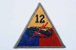 "<p>Insignia of the <a href=""/narrative/8066/en"">12th Armored Division</a>. ""Hellcats, "" the winning entry in a division contest for a nickname held in early in 1943, symbolized the 12th's toughness and readiness for combat.</p>"