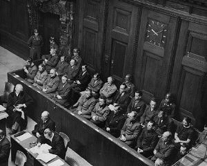 "<p>The defendants' dock and members of the defense counsel during the <a href=""/narrative/9245/en"">Doctors Trial</a>. Nuremberg, Germany, December 9, 1946–August 20, 1947.</p>"