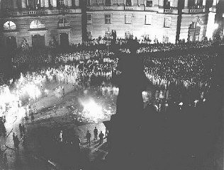 """<p>Crowds gather at Berlin's Opernplatz (opera square) for the <a href=""""/narrative/7631/en"""">burning of books</a> deemed """"un-German."""" Berlin, Germany, May 10, 1933.</p>"""