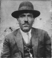 """<p>Portrait of David Aruti, son of Isak Aruti. He was a merchant and lived at Zvornitska 26 in Bitola.</p> <p>This photograph was one of the individual and family portraits of members of the Jewish community of <a href=""""/narrative/9092/en"""">Bitola</a>, Macedonia, used by <a href=""""/narrative/5955/en"""">Bulgarian occupation authorities</a> to register the Jewish population prior to its deportation in March 1943.</p>"""