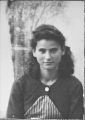 """<p>Portrait of Buena Eschkenasi, daughter of Bohor Eschkenasi. She lived at Zmayeva 10 in Bitola.</p> <p>This photograph was one of the individual and family portraits of members of the<a href=""""/narrative/9092/en"""">Jewish community of Bitola</a>, Macedonia, used by Bulgarian occupation authorities to register the Jewish population prior to its deportation in March 1943.</p>"""