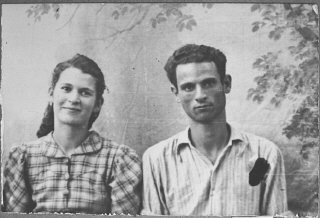 """<p>Portrait of Yosef Eschkenasi and his wife, Sara. Yosef was a laborer. They lived at Zmayeva 10 in Bitola.</p> <p>This photograph was one of the individual and family portraits of members of the Jewish community of<a href=""""/narrative/9092/en"""">Bitola</a>, Macedonia, used by<a href=""""/narrative/5955/en"""">Bulgarian occupation authorities</a>to register the Jewish population prior to its deportation in March 1943.</p>"""