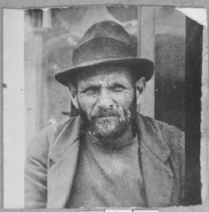 """<p>Portrait of Mordechai Mishulam. He was a dealer of second-hand items. He lived at Zmayeva 23 in Bitola.</p> <p>This photograph was one of the individual and family portraits of members of the Jewish community of<a href=""""/narrative/9092/en"""">Bitola</a>, Macedonia, used by<a href=""""/narrative/5955/en"""">Bulgarian occupation authorities</a>to register the Jewish population prior to its deportation in March 1943.</p>"""
