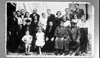 """<p>Portrait of the family of Bohor Kalderon.</p> <p>This photograph was one of the individual and family portraits of members of the Jewish community of<a href=""""/narrative/9092/en"""">Bitola</a>, Macedonia, used by<a href=""""/narrative/5955/en"""">Bulgarian occupation authorities</a>to register the Jewish population prior to its deportation in March 1943.</p>"""
