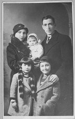 """<p>Portrait of Yakov Testa with wife and three children in Bitola.</p> <p>This photograph was one of the individual and family portraits of members of the <a href=""""/narrative/9092/en"""">Jewish community of Bitola</a>, Macedonia, used by <a href=""""/narrative/5955/en"""">Bulgarian occupation authorities</a> to register the Jewish population prior to its deportation in March 1943.</p>"""