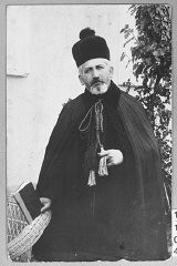 """<p>Portrait of Rabbi S. Djain, taken in Bitola.</p> <p>This photograph was one of the individual and family portraits of members of the <a href=""""/narrative/9092/en"""">Jewish community of Bitola</a>, Macedonia, used by Bulgarian occupation authorities to register the Jewish population prior to its deportation in March 1943.</p>"""