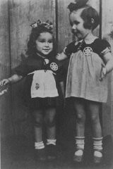 "<p>Two young cousins shortly before they were smuggled out of the <a href=""/narrative/3182/en"">Kovno</a> ghetto. A Lithuanian family hid the children and both girls survived the war. Kovno, Lithuania, August 1943.</p>"