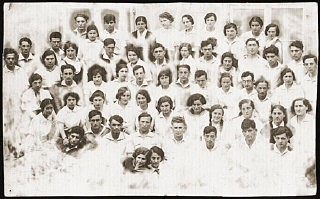 "<p>Group portrait of the members of the Zionist pioneer youth group, Ha-Shomer ha-Tsa'ir Hachshara. <a href=""/narrative/9238/en"">Kalisz</a>, Poland, May 1, 1935.</p>"