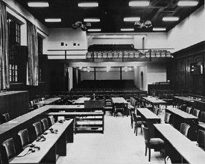 "<p>The remodeled courtroom at Nuremberg, site of the <a href=""/narrative/9366/en"">International Military Tribunal</a>. Germany, November 15-20, 1945.</p>"