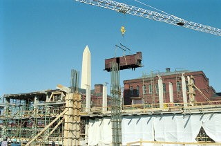 <p>Installation of the railcar at the construction site of the United States Holocaust Memorial Museum. Washington, DC, February 9, 1991.</p>