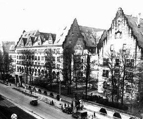 """<p>View of the Palace of Justice (left), where the <a href=""""/narrative/9366/en"""">International Military Tribunal</a> trial was held. Nuremberg, Germany, November 17, 1945.</p> <p>The Palace of Justice was selected by the Allied powers as the <a href=""""/narrative/9695/en"""">location</a> for the International Military Tribunal (IMT) because it was the only undamaged facility extensive enough to accommodate a major trial. The site contained 20 courtrooms and a prison capable of holding 1,200 prisoners.</p>"""