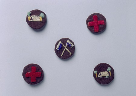 "<p>Boy Scout handmade badges worn by German-Jewish refugee boys. British expatriates had transplanted the Boy Scouts to Shanghai before the refugees' arrival. Unlike most of the Polish Jewish refugees, German and Austrian Jews usually went to Shanghai as families, and enrollment in schools and youth organizations in the International Settlement grew rapidly. [From the USHMM special exhibition <a href=""/narrative/10592/en"">Flight and Rescue</a>.]</p>"