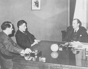 <p>Meeting of the War Refugee Board in the office of Executive Director John Pehle. Pictured left to right are Albert Abrahamson, Assistant Secretary of the Treasury Josiah Dubois, and Pehle. Washington, DC, United States, March 21, 1944.</p>