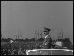 <p>In the 1920s and 1930s, the German city of Nuremberg was host to massive and lavish rallies for the Nazi Party. This film footage, produced by Julien Bryan in 1937, shows saluting crowds in the Nuremberg stadium watching groups parade past Adolf Hitler.</p>