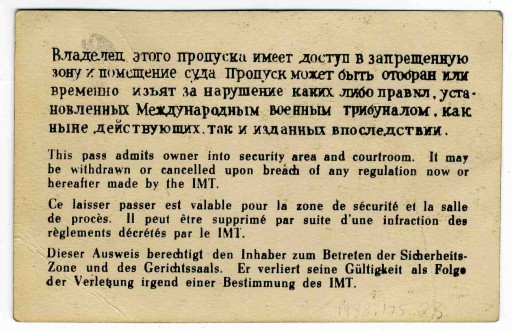 <p>Back side of an entry pass to the court building at the International Military Tribunal. This pass was issued to a U.S. military guard. The pass is printed in each of the IMT's four official languages.</p>