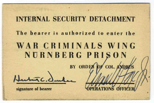 <p>Back side of an entry pass to the prison housing war criminals at the International Military Tribunal. This pass was issued to a U.S. military guard.</p>