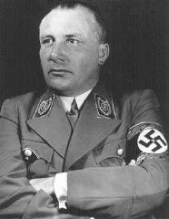 "<p>Portrait of Nazi Party official <a href=""/narrative/9808/en"">Martin Bormann</a>. Bormann died in an effort to flee Berlin in the last days of World War II, but was long thought to be at large. He was tried in absentia at the International Military Tribunal in Nuremberg, where he was sentenced to death.</p>"