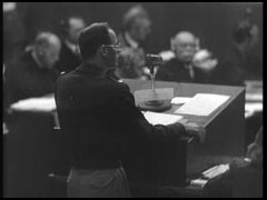 <p>Lieutenant Colonel Baldwin of the US prosecution team presents the case against defendant Hans Frank at the Nuremberg trial. Baldwin refers to several of Frank's diary entries about the appropriation of scarce Polish grain for use as food in Germany.</p>