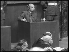<p>Defendant Hans Frank gives testimony to his defense lawyer during the Nuremberg trial about his leadership roles during the Third Reich.</p>